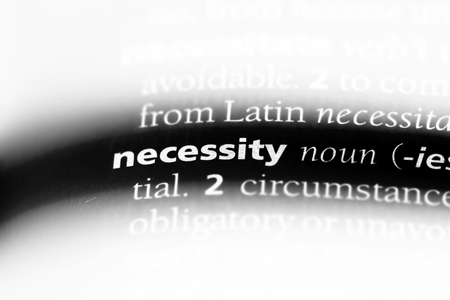 necessity word in a dictionary. necessity concept. Stock Photo