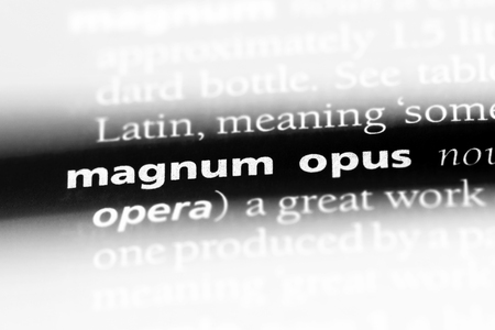 magnum opus word in a dictionary. magnum opus concept. Stock Photo