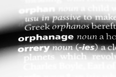 orphanage word in a dictionary. orphanage concept.