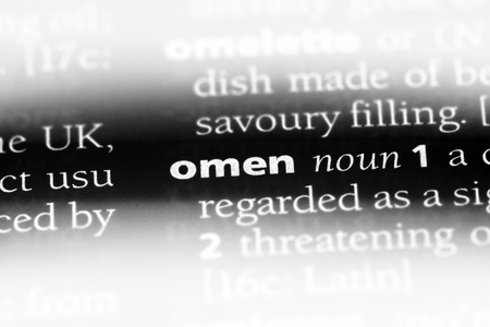 omen word in a dictionary. omen concept.
