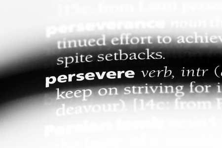 persevere word in a dictionary. persevere concept. Stockfoto - 107597325