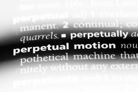 perpetual motion word in a dictionary. perpetual motion concept. Banco de Imagens