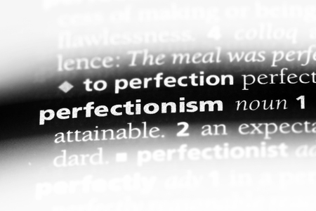 perfectionism word in a dictionary. perfectionism concept.