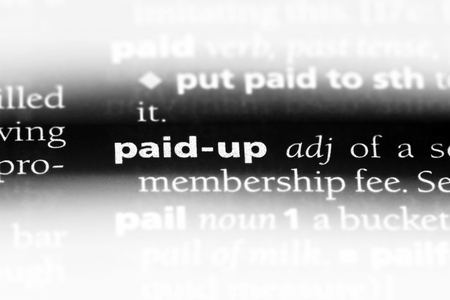 paid up word in a dictionary. paid up concept.