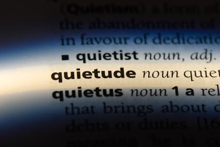 quietude word in a dictionary. quietude concept. Banco de Imagens - 107660350