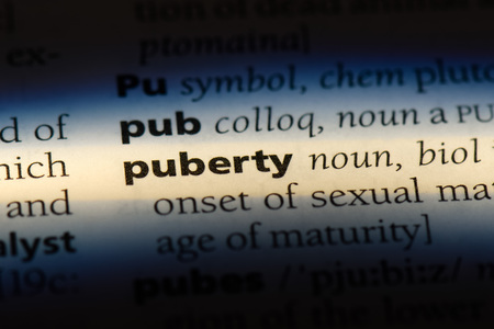 puberty word in a dictionary. puberty concept.