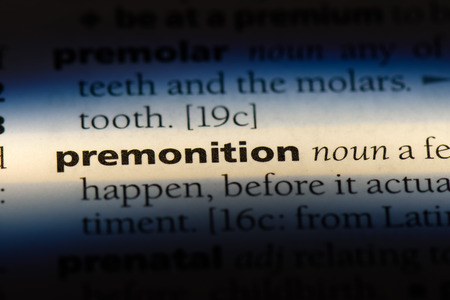 premonition word in a dictionary. premonition concept.