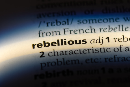 rebellious word in a dictionary. rebellious concept.
