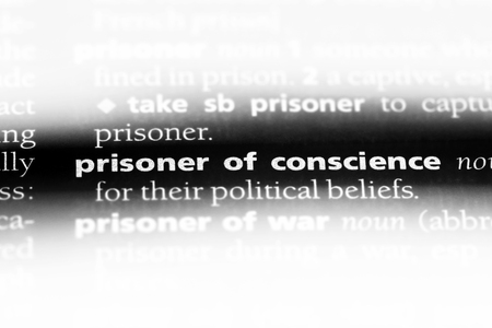 prisoner of conscience word in a dictionary. prisoner of conscience concept.
