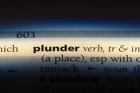 plunder word in a dictionary. plunder concept.