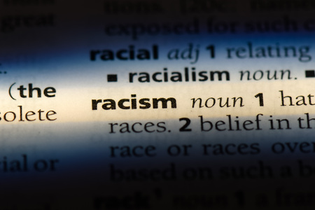 racism word in a dictionary. racism concept.