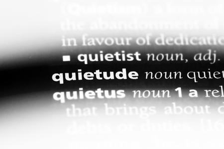quietude word in a dictionary. quietude concept.