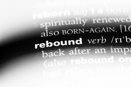rebound word in a dictionary. rebound concept. Фото со стока