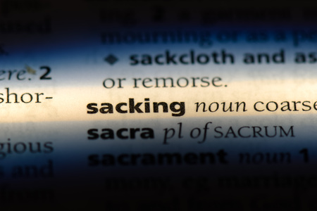 sacking word in a dictionary. sacking concept. Stok Fotoğraf