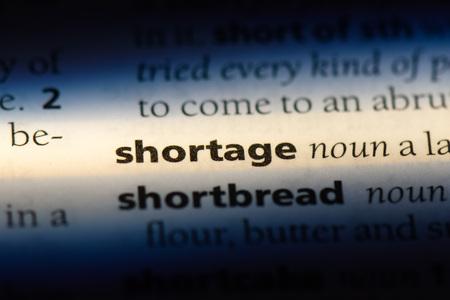 shortage word in a dictionary. shortage concept.
