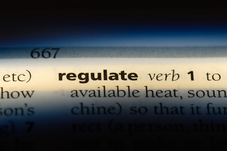 regulate word in a dictionary. regulate concept. Фото со стока