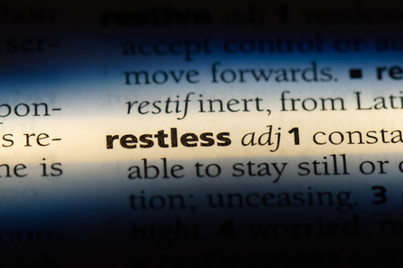 restless word in a dictionary. restless concept.