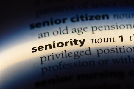 seniority word in a dictionary. seniority concept. Banco de Imagens - 107770116