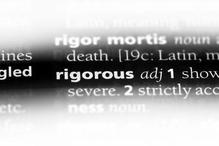 rigorous word in a dictionary. rigorous concept. Stock Photo