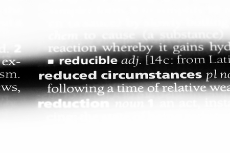 reduced circumstances word in a dictionary. reduced circumstances concept. Stok Fotoğraf