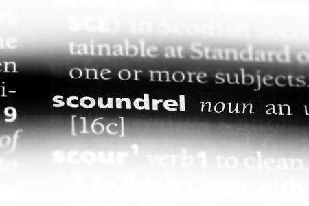 scoundrel word in a dictionary. scoundrel concept. 写真素材