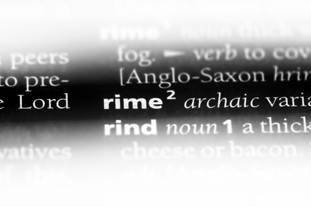 rime word in a dictionary. rime concept. Stok Fotoğraf