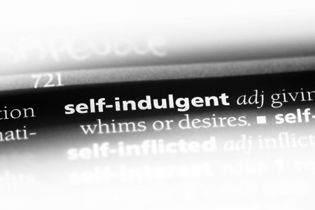 self indulgent word in a dictionary. self indulgent concept.