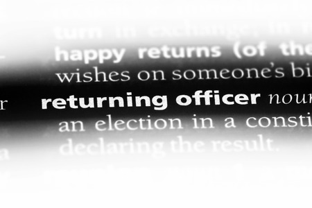 returning officer word in a dictionary. returning officer concept. Stok Fotoğraf