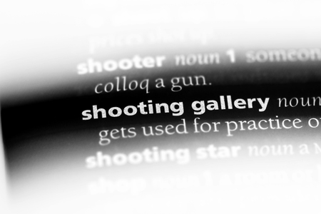 shooting gallery word in a dictionary. shooting gallery concept. 스톡 콘텐츠