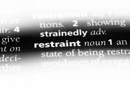 restraint word in a dictionary. restraint concept.