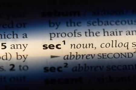 sec word in a dictionary. sec concept. Фото со стока