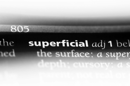 superficial word in a dictionary. superficial concept. Stock Photo