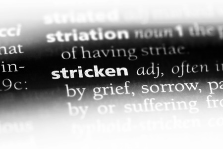 stricken word in a dictionary. stricken concept.