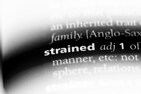 strained word in a dictionary. strained concept. Stock fotó
