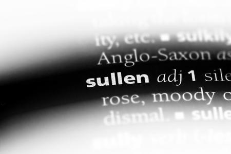 sullen word in a dictionary. sullen concept. Фото со стока