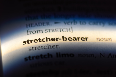 stretcher bearer word in a dictionary. stretcher bearer concept.