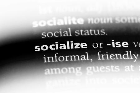 socialize word in a dictionary. socialize concept. Archivio Fotografico - 107036973