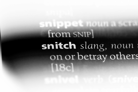 snitch word in a dictionary. snitch concept. Stock Photo