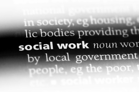 social work word in a dictionary. social work concept.