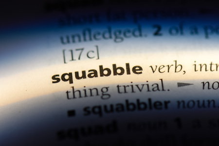 squabble word in a dictionary. squabble concept.