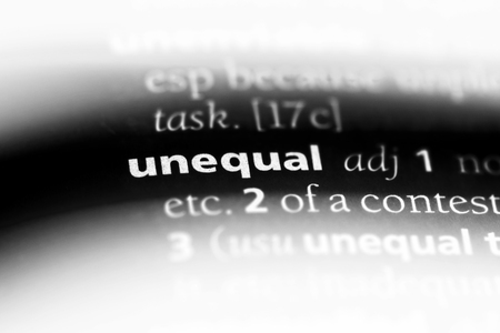 unequal word in a dictionary. unequal concept. Stock Photo