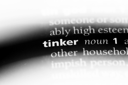 tinker word in a dictionary. tinker concept.