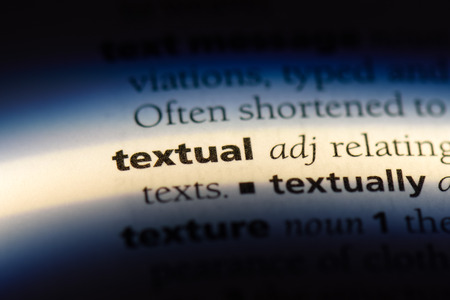 textual word in a dictionary. textual concept.
