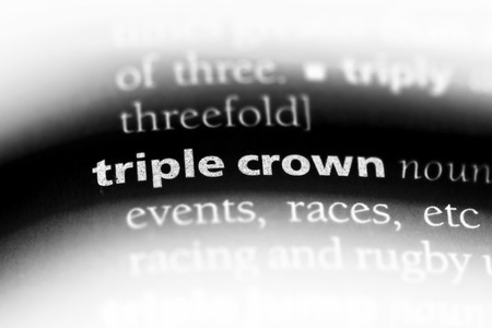 triple crown word in a dictionary. triple crown concept.
