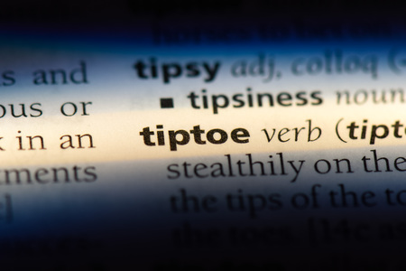 tiptoe word in a dictionary. tiptoe concept.