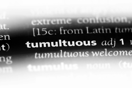 tumultuous word in a dictionary. tumultuous concept.