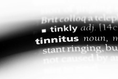 tinnitus word in a dictionary. tinnitus concept. 스톡 콘텐츠