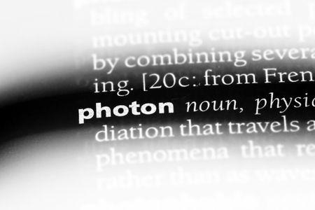 photon word in a dictionary. photon concept.