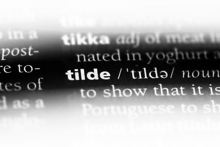 tilde word in a dictionary. tilde concept. Banco de Imagens