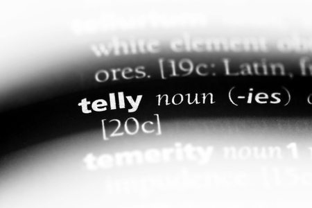 telly word in a dictionary. telly concept. Banco de Imagens